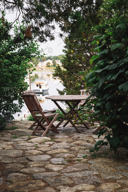 Outdoor seating by the water at Lobster Cove, Massachusetts