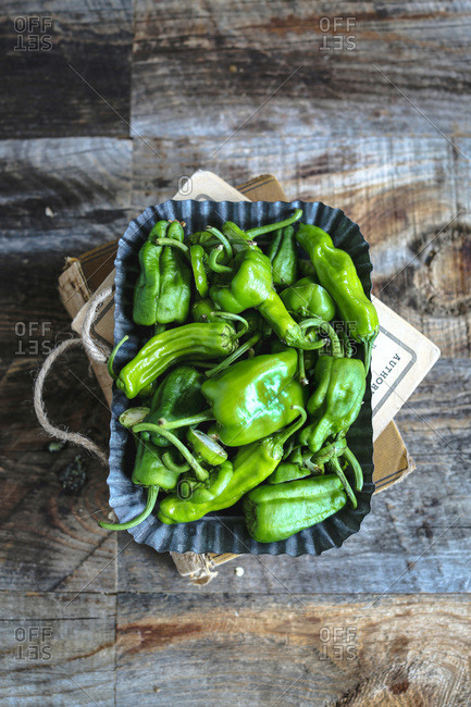 Overhead view of a tin of fresh green peppers