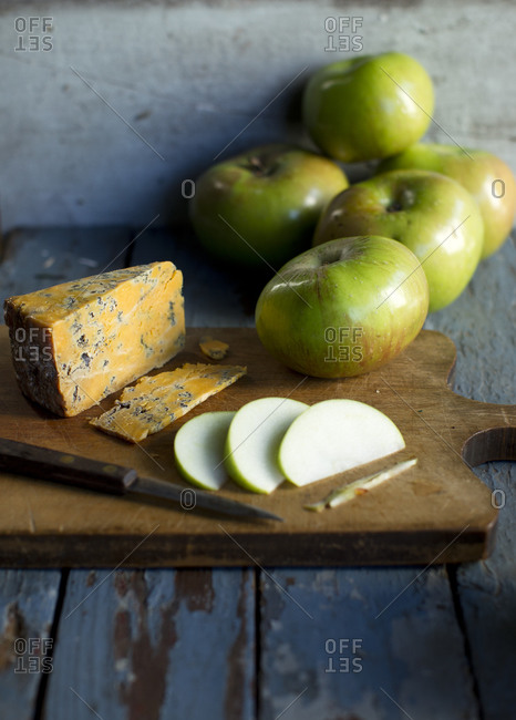 Sliced apples and cheese on a cutting board