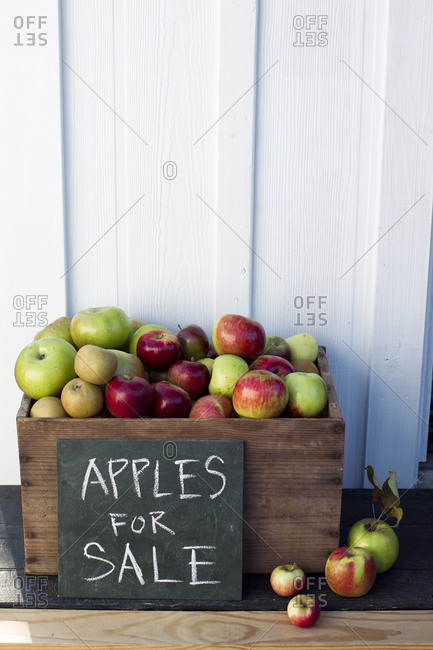Wooden box of apples for sale
