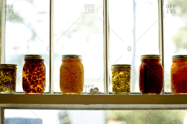 Jars of jellies and preserves on a window sill