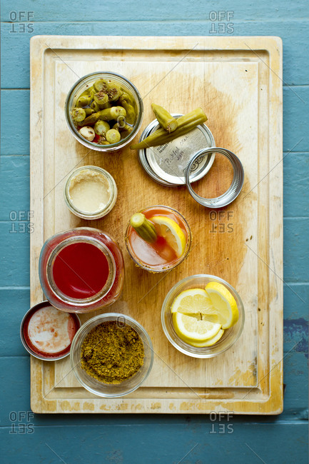 Bloody Mary ingredients on a cutting board