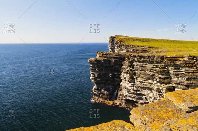 Rugged cliffs along the coast of Orkney Islands, Scotland