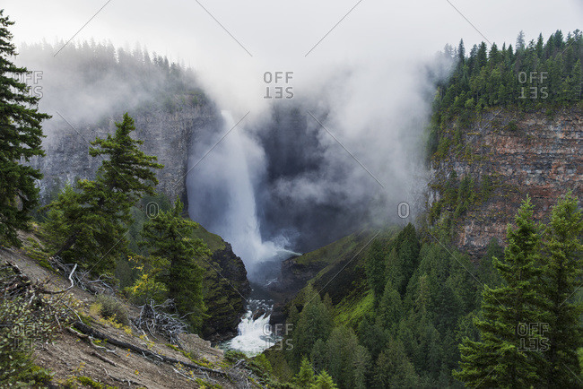 Fog surrounds Helmcken Falls in Wells Gray Provincial Park, British Columbia, Canada