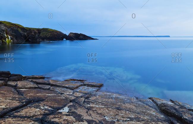 Coastline of Orkney Islands at dusk in Orkney, Scotland