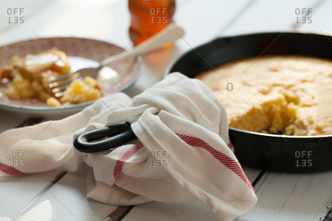 Skillet and plate of fresh cornbread
