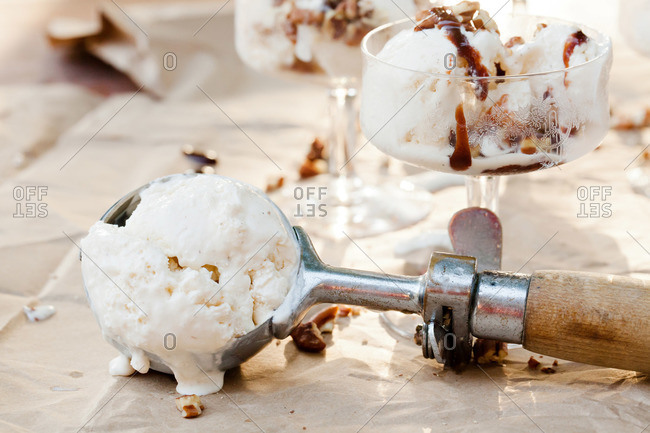 Ice cream in scoop and glasses