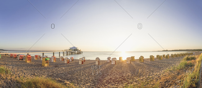 View to Timmendorfer Strand with hooded beach chairs and sea bridge, Niendorf