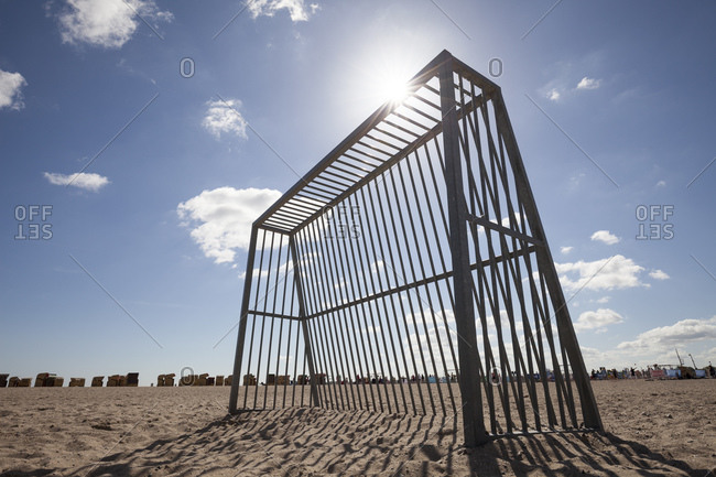 Soccer goal on the beach at backlight, Luebeck Travemuend