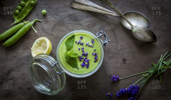 Green gazpacho in a jar with peas and lavender
