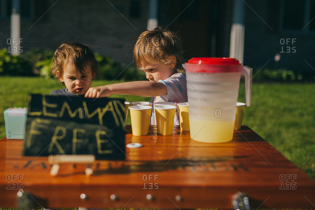 Two young children at their lemonade stand