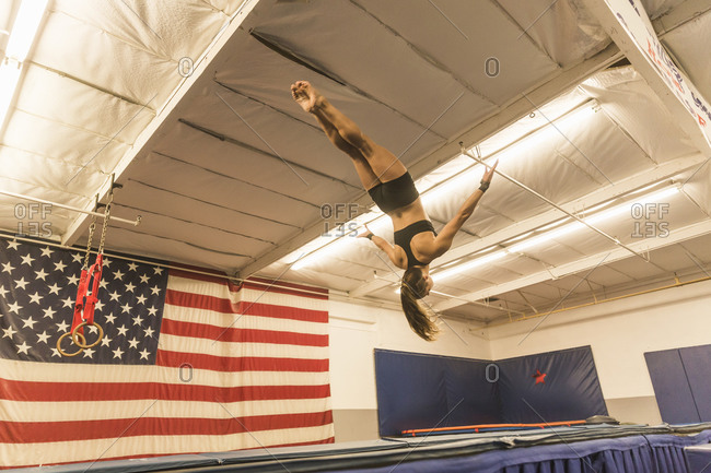 A gymnast flies through the air
