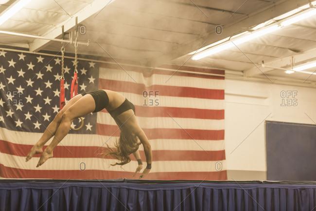 A gymnast does a backflip