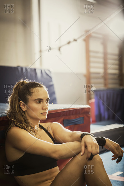 A gymnast rests after practice