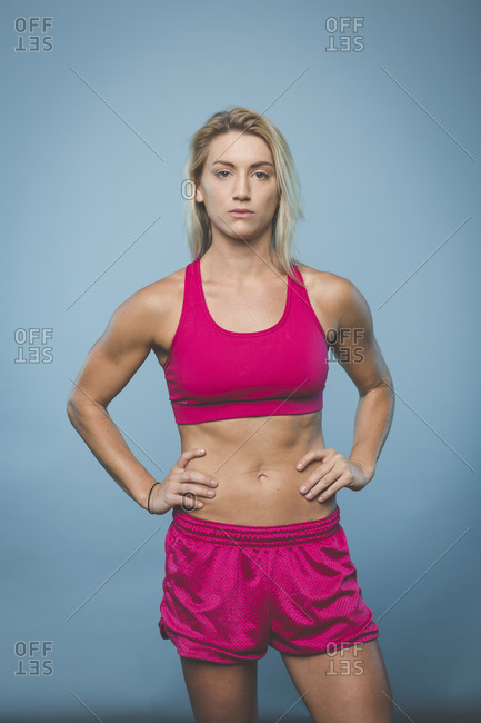 Physically fit woman in work out clothes