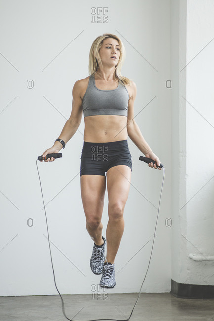 Woman jumping rope to keep fit