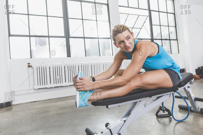 Physically fit woman doing leg stretches