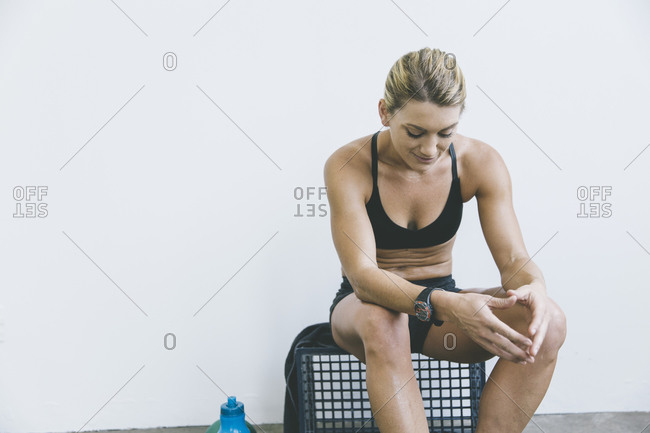Woman sitting after a work out
