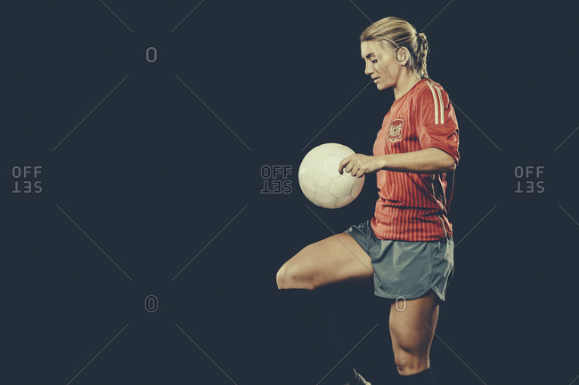 Female soccer player playing with ball