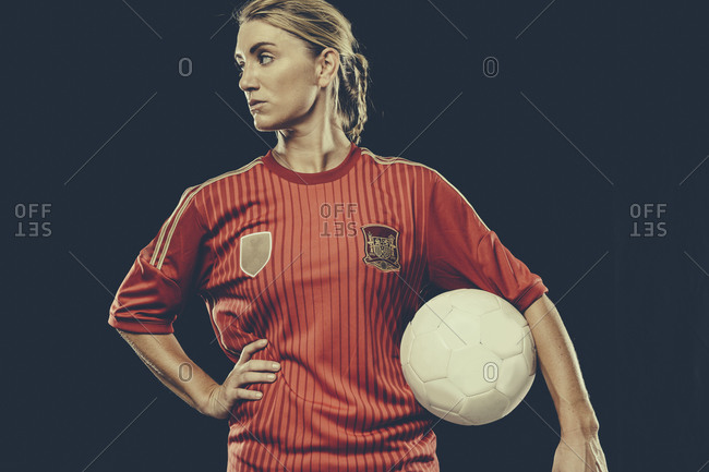 Portrait of a female soccer player with ball