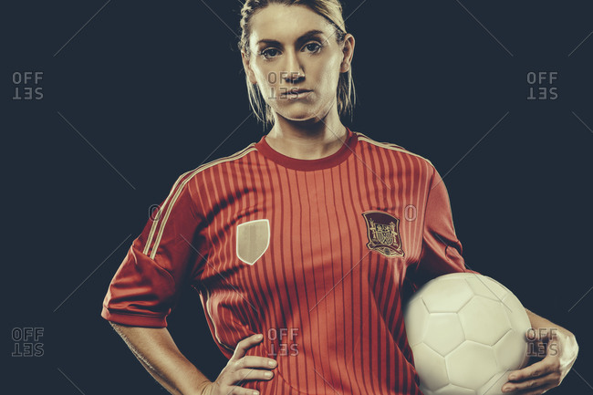 Portrait of a female soccer player holding ball