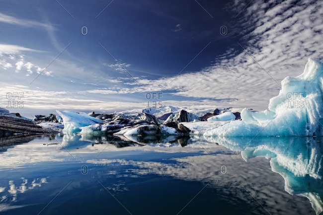 Icelandic lagoon reflecting glaciers and sky