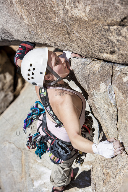 Female climber scanning her route