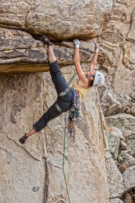 Climber dangles from cliff overhang