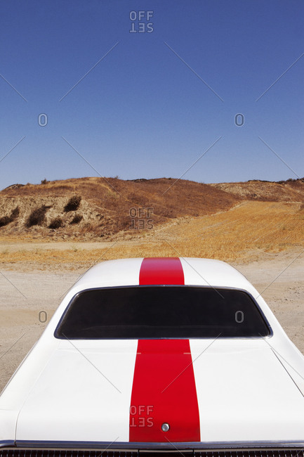 Classic racing car in desert setting