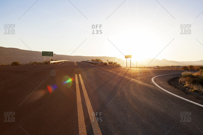 Road intersection in rural desert setting