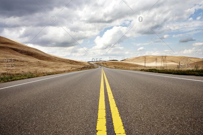 Two lane road through rural desert setting