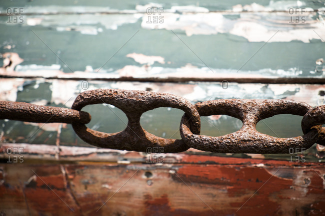 Close up of rusty chain by boat