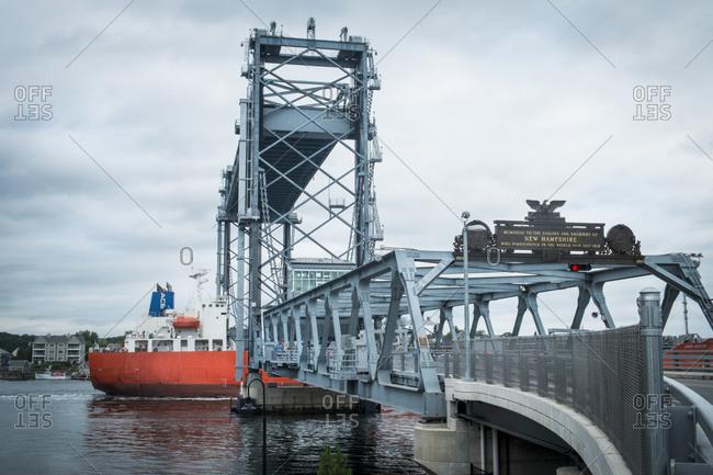 Boat passing through drawbridge in New Hampshire