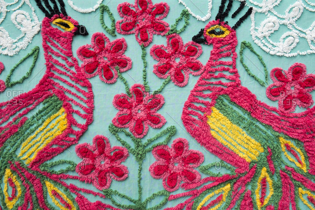 Peacock design embroidered on a blanket