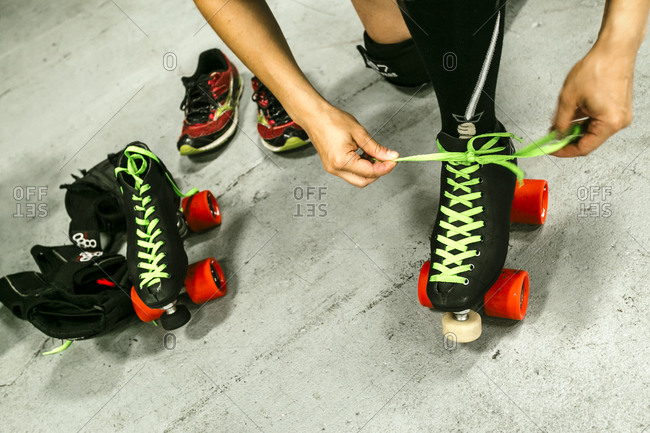 Roller derby competitor putting on skates