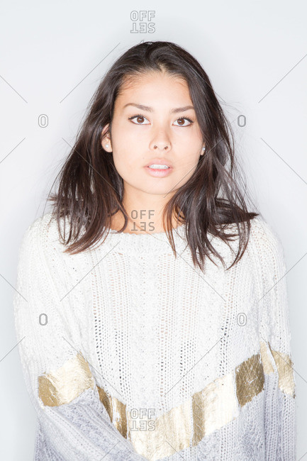 A young woman in a white sweater