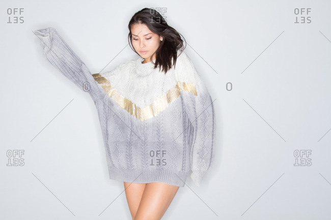 A young woman in an oversized sweater