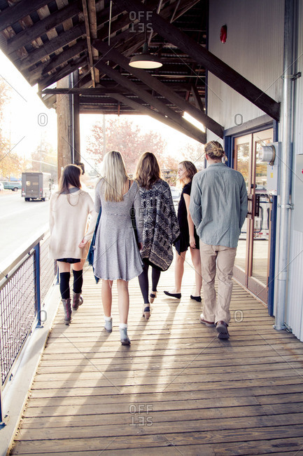 A group of friends walk to a store
