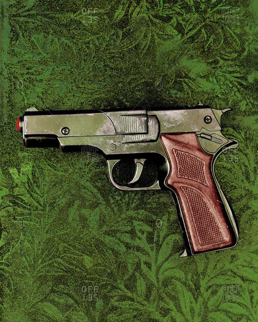 Water gun pistol on a green background
