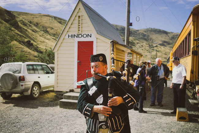 Dunedin, New Zealand - February 26, 2015: Bagpipe player at the Hindon stop on the Taieri Gorge Railway in New Zealand