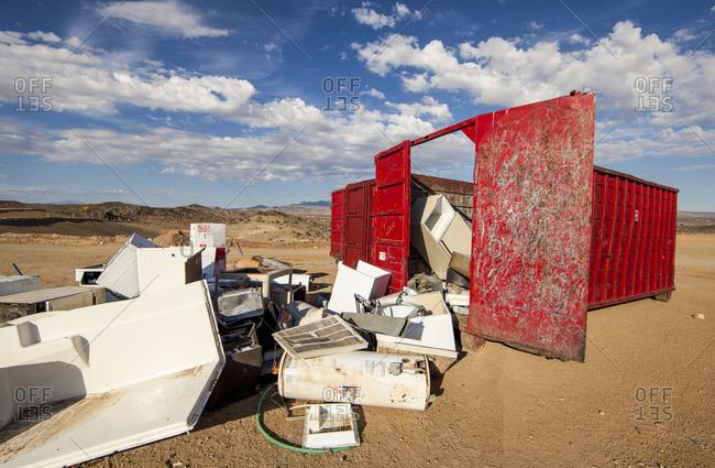 Broken appliances at the scrap metal dumpster