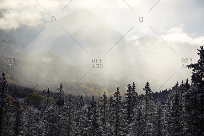 Sunbeams over majestic mountain scene