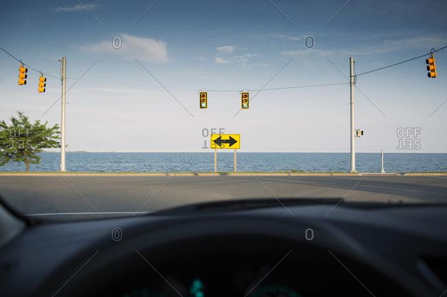 Ocean T-intersection seen from car window