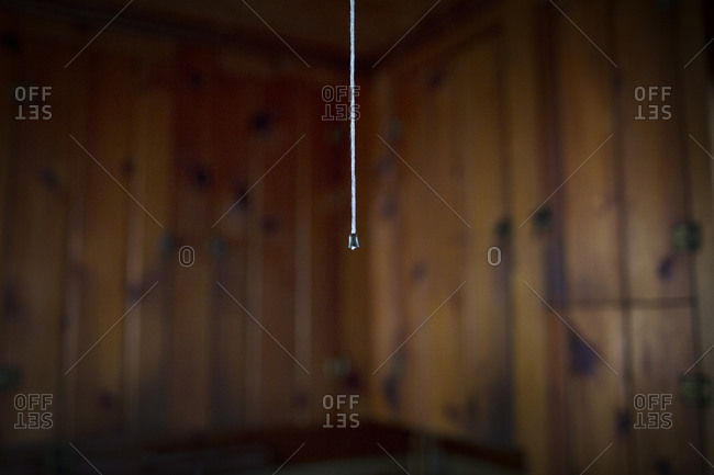 Light string hanging by kitchen cupboards