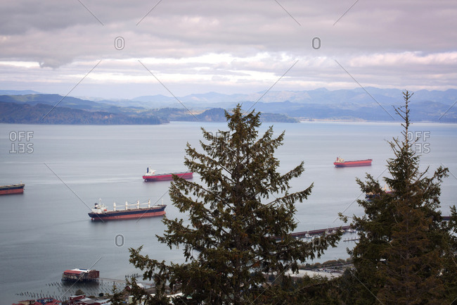 Cargo ships gathered on water