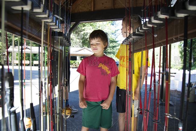 Boys selecting a fishing pole