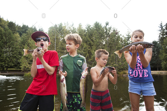 Group of kids holding up their fishing haul