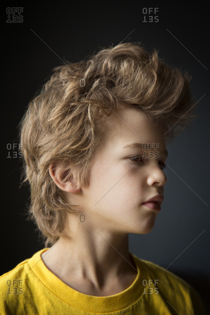 Portrait of young boy with tousled hair