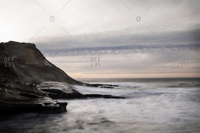 Rocky barren coastline along ocean