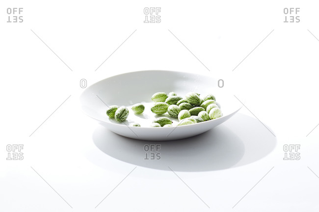 Mexican cucumbers in white ceramic dish on white surface